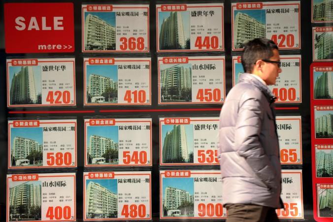 Агенты китайской недвижимости говорят, что сейчас самое время продавать и покупать. Фото: Peter Parks/AFP/Getty Images