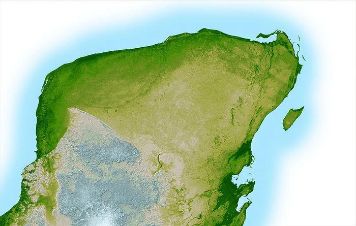 Топографическая карта полуострова Юкатан. В верхней левой части полуострова , слабая дуга темно - зеленого цвета указывает на остатки ударного кратера Чиксулуб. Фото: NASA