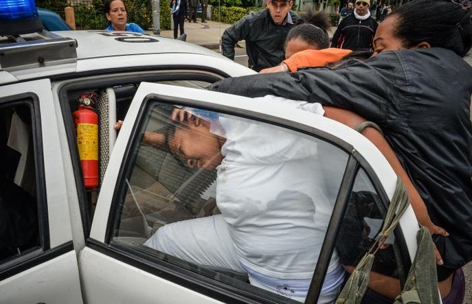 Арест женщины-активистки в Гаване. Фото: ADALBERTO ROQUE/AFP/Getty Images