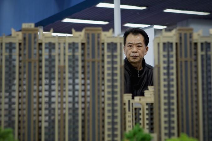 Модели домов в Пекине, 9 апреля 2011 г. Фото: Lintao Zhang/Getty Images