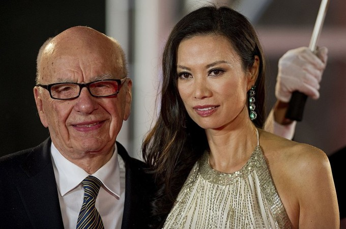 (FILES) This file photo taken on June 11, 2011 shows media executive Rupert Murdoch (L) and his wife Wendi Deng arriving on the red carpet during the opening ceremony of the Shanghai International Film Festival (SIFF) in Shanghai. Wendi Deng, who has emerged as an unlikely heroine after leaping to defend her 80-year-old husband Rupert Murdoch from a pie-wielding protester on July 19, 2011, has a reputation for formidable ambition and fierce loyalty. AFP PHOTO / FILES / Philippe Lopez (Photo credit should read PHILIPPE LOPEZ/AFP/Getty Images)