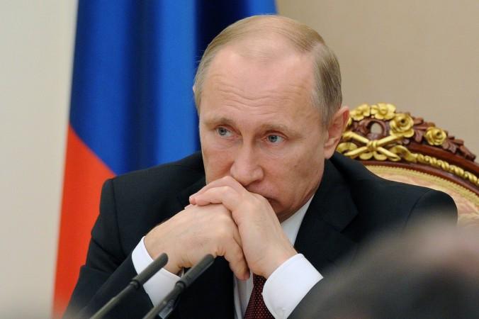 Президент РФ проводит правительственную встречу в Москве 25 марта 2015 г. По слухам, Путин встречается с Вэнди Дэн, бывшей женой Руперта Мэрдока. Фото: Mikhail Klimentyev/AFP/Getty Images