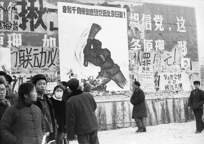 "BEIJING, CHINA - JANUARY21: A small group of Chinese youths walk past several dazibaos, the revolutionary placards, in February 1967 in downtown Beijing, during the ""Great Proletarian Cultural Revolution"". Since the the cultural revolution was launched in May 1966 at Beijing University, Mao's aim was to recapture power after the failer of the ""Great Leap Forward"". (Photo credit should read JEAN VINCENT/AFP/Getty Images)"