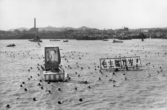 "A picture released by the Chinese official news agency shows some 5,000 Chinese following Chairman Mao Zedong's example swimming 02 September 1967, in the Yangtze river, near Wuhan, displaying floating portraits of the Great Helmsman and slogans calling for him a ""10,000 year"" life. Right after swimming in the Yangtze river, Mao went back to Beijing to head the Great Proletarian Cultural Revolution against his former comrade Lin Piao and Deng Xiaoping, bringing Red China close to a civil war. CHINA OUT AFP PHOTO/XINHUA (Photo credit should read STR/AFP/Getty Images)"