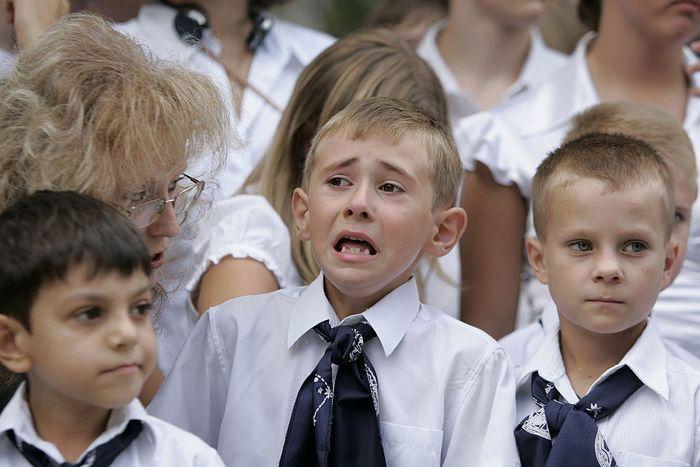 Первоклассники. Фото: MIKHAIL MORDASOV/AFP/Getty Images