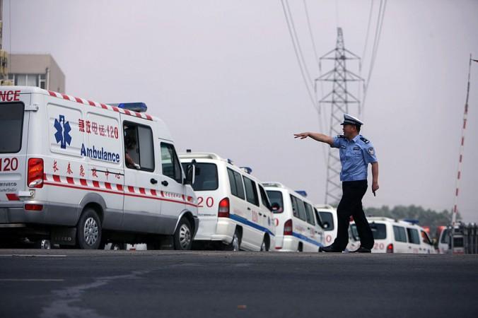 Машины скорой помощи в провинции Цзилинь в Китае, 3 июня 2013 г. Фото: STR/AFP/Getty Images