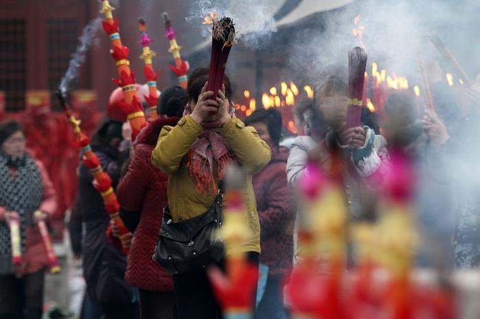 Большинство коммунистов в Китае имеют «вторую веру»