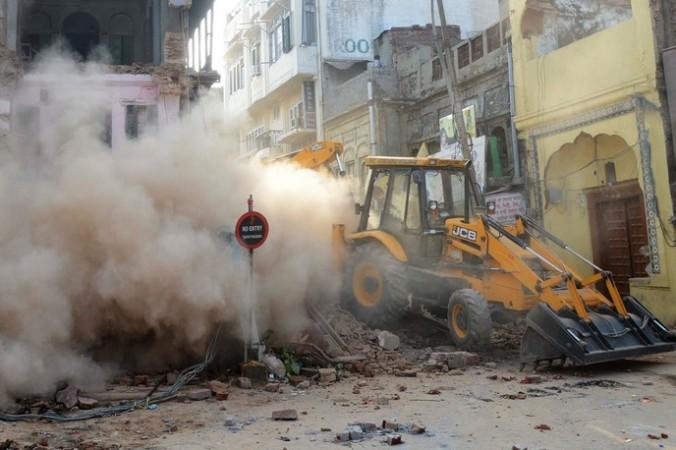 Снос торговых точек. Фото:  NARINDER NANU/AFP/Getty Images