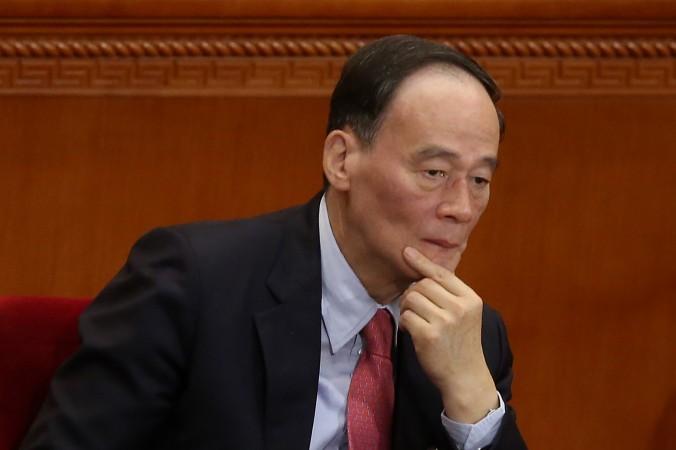 Секретарь центральной комиссии компартии Китая по проверке дисциплины Ван Цишан на заседании национального народного конгресса 5 марта 2014 г. в Китае. Фото: Feng Li/Getty Images