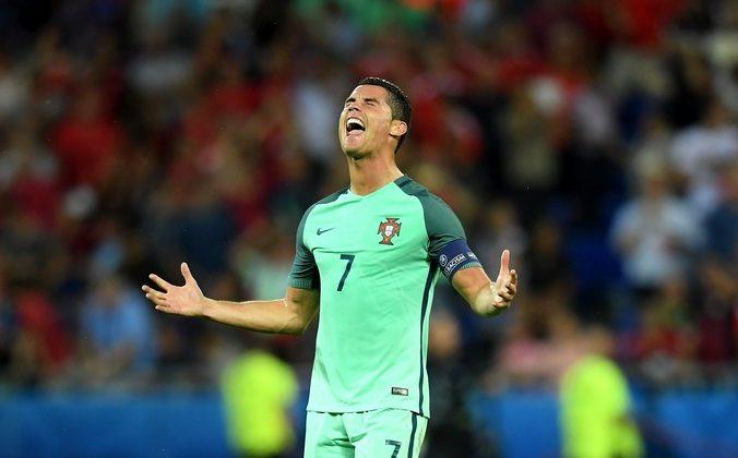 Криштиану Роналду забил гол в матче Португалия — Уэльс на чемпионате Европы, Франция, 6 июля, 2016 год. Фото: Matthias Hangst/Getty Images