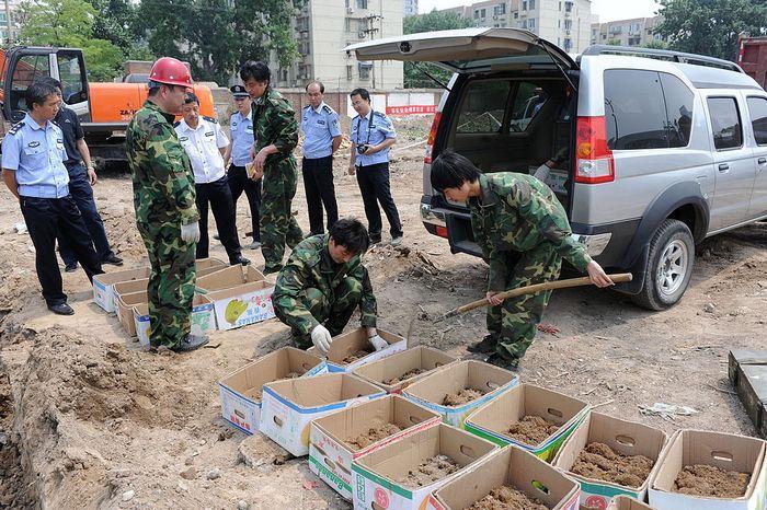 Обнаруженные снаряды Второй мировой войны на территории Китая. Фото: AFP/AFP/Getty Images
