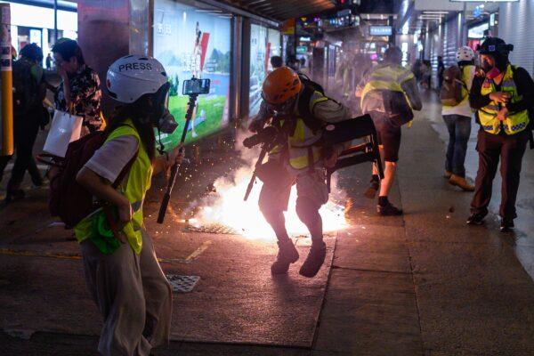 Введут ли власти Гонконга официальную регистрацию журналистов? Пресса и активисты заранее против