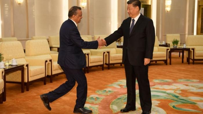 Тедрос Аданом Гебреисус, Генеральный директор ВОЗ и глава Китая Си Цзиньпин.