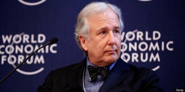 Мэтью Винклер, главный редактор Bloomberg News, во время заседания форума в день открытия Всемирного экономического форума (ВЭФ) в Давосе, Швейцария. 23 января 2013 года