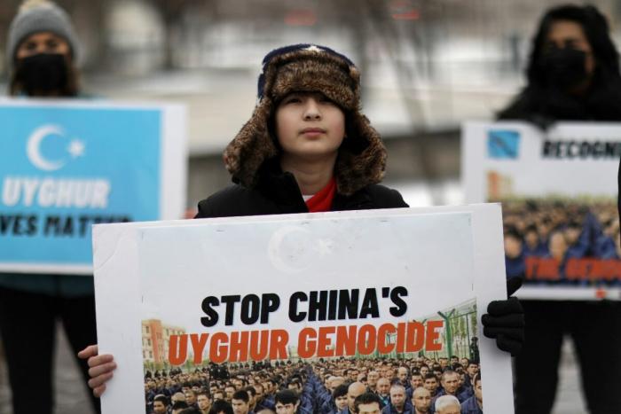 Xinjiang protest 1200x800 1 e1624096186480 - В четырёх стратегических направлениях сотрудничества Китая и ЕС обострились проблемы